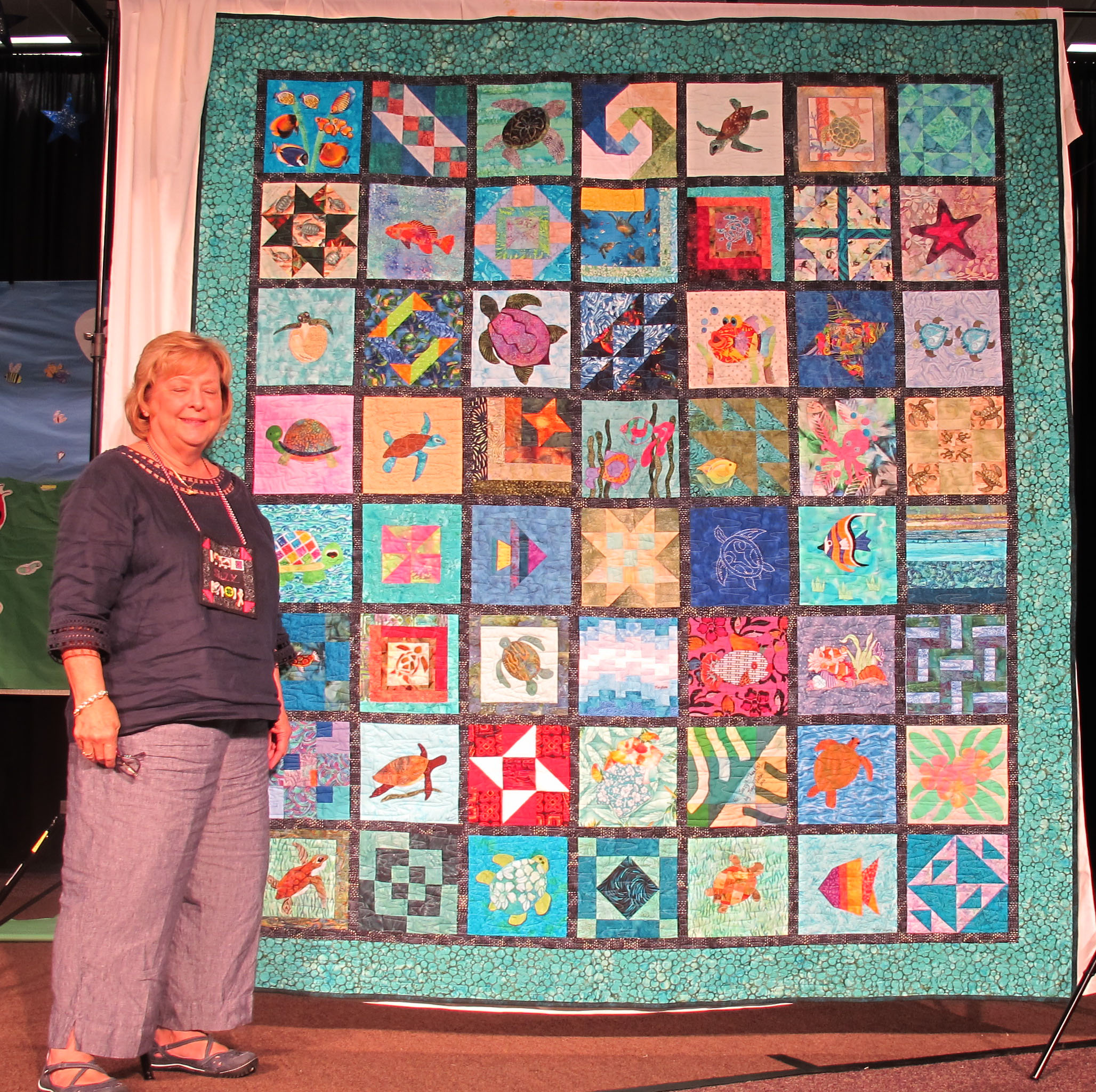 suzi-weinbach-with-presidents-quilt
