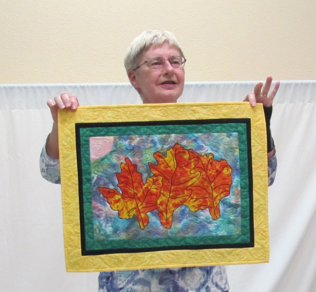 Lorraine Marstall - Blowin' in the Winde, Challenge was 'use your initials L.J.M. L-Leaf theme, J-Quilt design, M-Marigold colour